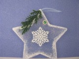Stern aus Windradfolie   transparent mit Tanne und Verzierungen